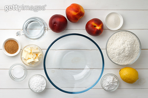 Ingredients for step by step recipe pie or galette on white wooden table.
