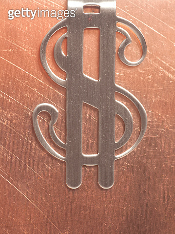 Dollar Sign on a Metal Background