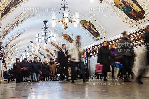passengers and tourists at the metro station Kievskaya