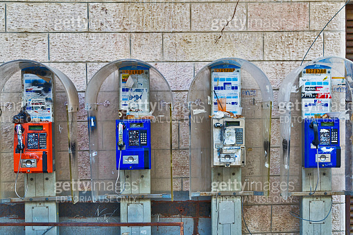Old telephone booths on the wall of the house in the orthodox quarter of Mea Shearim in Jerusalem