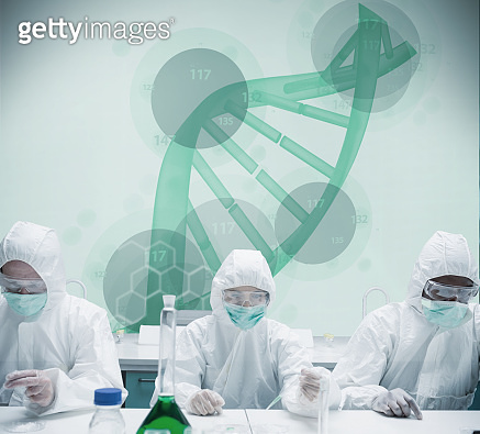 Chemists working in protective suit with futuristic interface showing green DNA