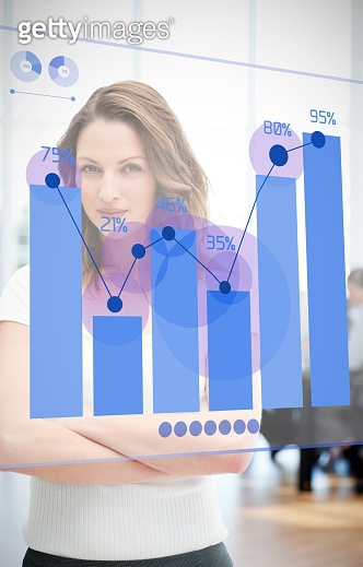 Confident businesswoman looking at blue diagram interface