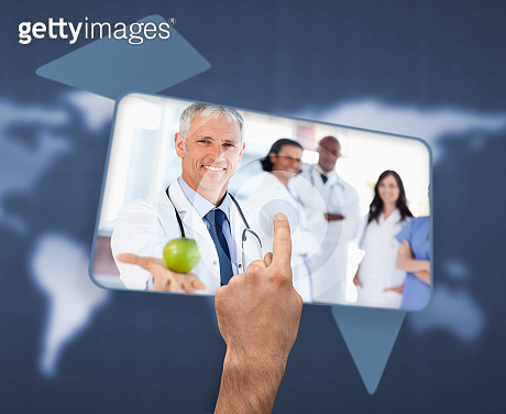 Hand selecting image of doctor holding apple
