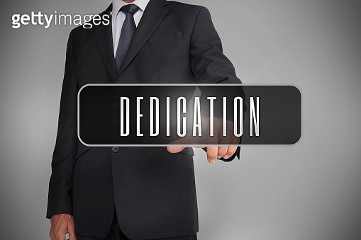 Businessman selecting label with dedication written on it