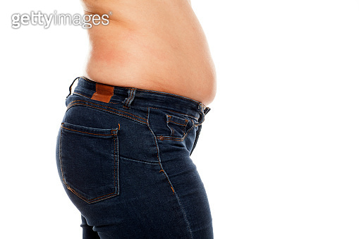 fat deposits in the waist and belly of young women on white background