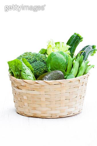 Fresh  green vegetables in wicker basket