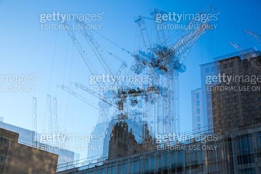 Multiple exposure image of building construction site. London, UK