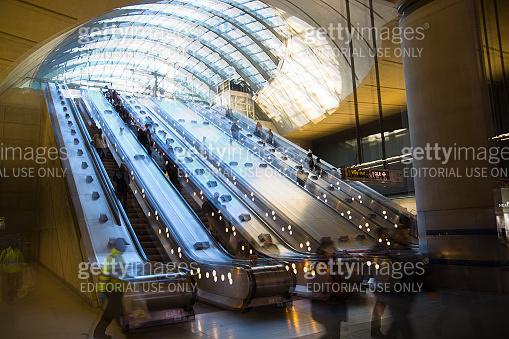 Underground station entrance with escalators.  London