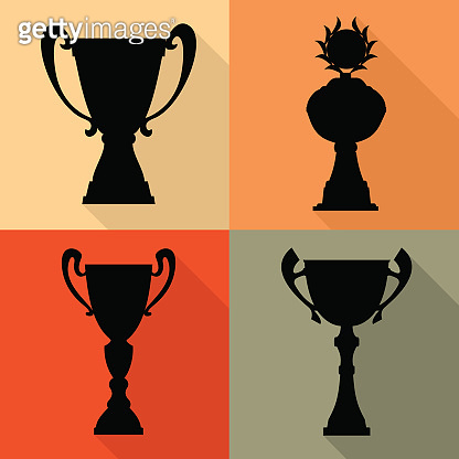 Set of four vector trophy champion cups in flat style.