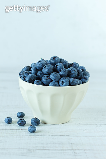 Still life with a ceramic bowl full of blueberries