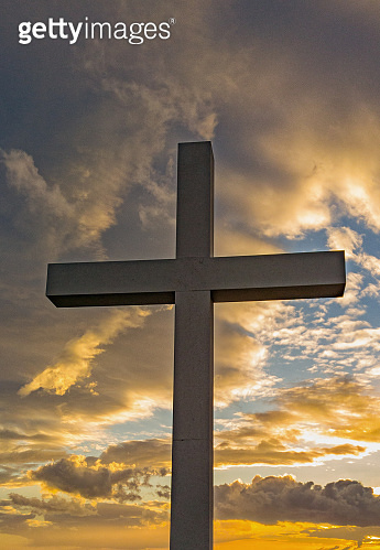 Cross Against Dramatic Clouds