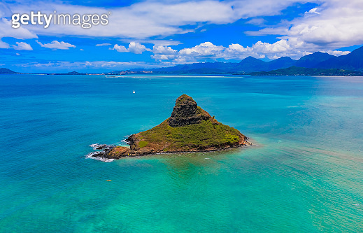 Aerial view of Oahu's coastline and Chinaman's Hat in Oahu Hawaii