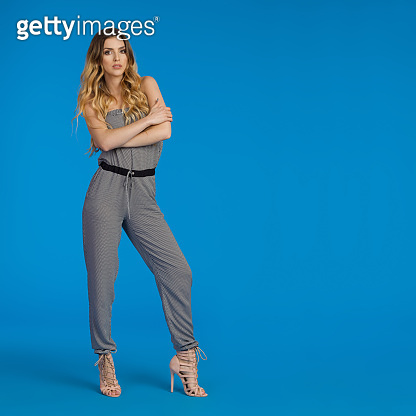 Serious Fashion Model In Jumpsuit And High Heels