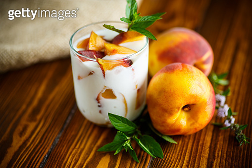 Sweet home-made yogurt with pieces of peach
