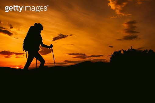 Woman Silhouette hiking on the Sunset