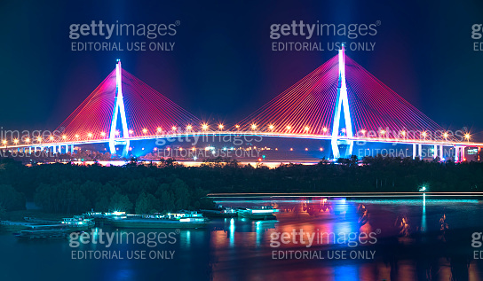 Can Tho cable bridge at night shimmering colorful coupled river banks