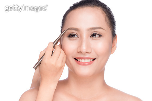 Closeup Of Beautiful Glamourous Asian Woman With Professional Makeup Contouring Brows With Eyebrow Pencil.
