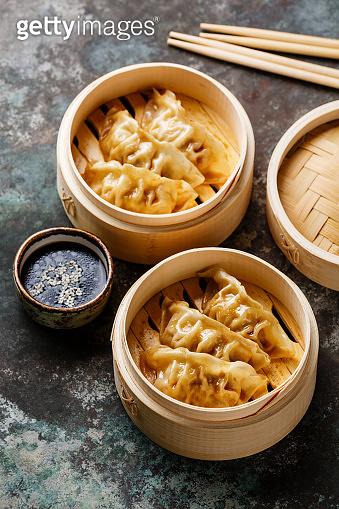 Steamed dumplings Gyoza in bamboo steamer