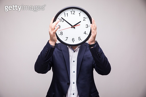 Handsome man with clock over head