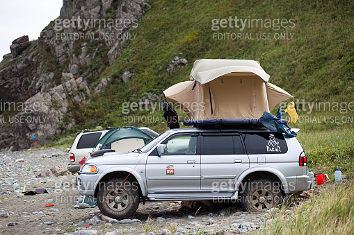 PREOBRAZHENIE, RUSSIA - AUGUST 24, 2014: Mitsubishi Pajero Sport with rooftop tent on a beach