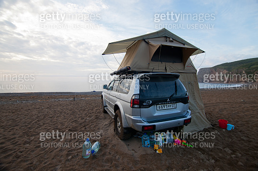 KAVALEROVO, RUSSIA - AUGUST 20, 2014: Mitsubishi Pajero Sport with rooftop tent on a beach