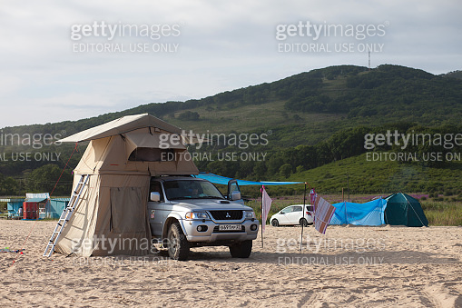 ANNA, RUSSIA - AUGUST 27, 2014: Mitsubishi Pajero Sport with rooftop tent on a  beach