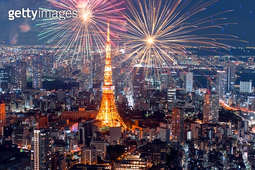 Amazing panoramic view to city centre of Tokyo with fireworks in the evening, Tokyo Tower at night