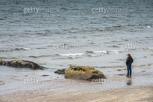 Tourist on the Ballingskelligs Bay Beach
