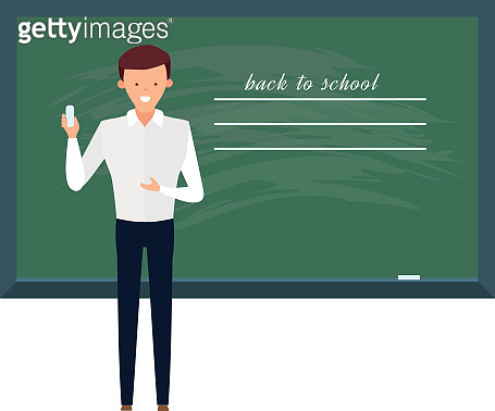 Teacher, professor standing in front of blank school blackboard