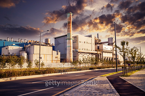 An industrial plant in the sunset