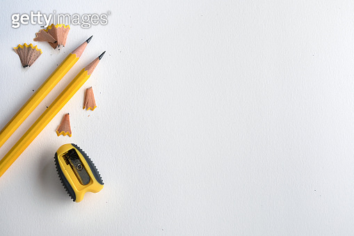 The Yellow pencil with shaving on white drawing watercolor paper , creative work tool project