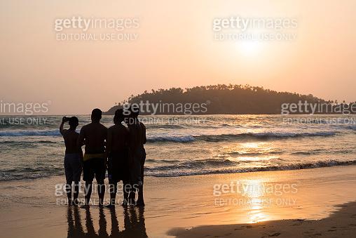 Group selfie at sunset in Mirissa, Sri Lanka