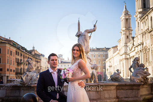 Bride and groom wedding poses in front of Piazza Navona, Rome, Italy