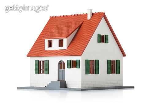 Miniature model house on white background