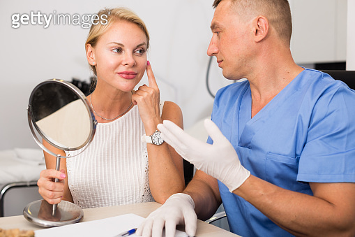 Female client is consultating with doctor before procedure