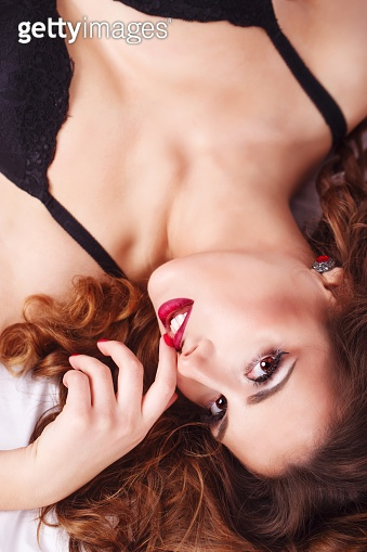 Girl in bra with red lips