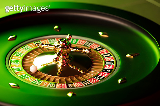 Casino roulette wheel. Green and red contrast light.
