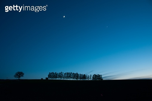 Hill of dusk and the moon