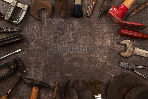 Set of Old Tools on Rustic Background