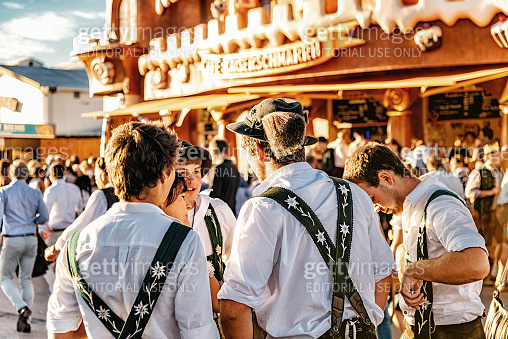 young man in bavarian clothe at oktoberfest in munich