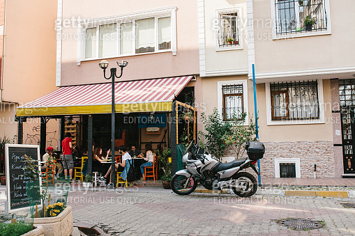 Istanbul, June 14, 2017: A popular street cafe in the Asian part of Istanbul in the Kadikoy district. Turkey. Lifestyle, leisure, communication of people, meeting friends.
