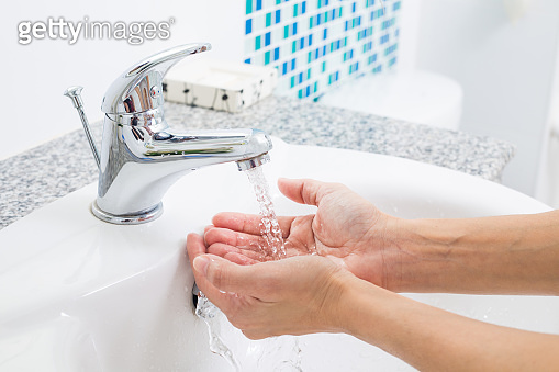 Hygiene. Cleaning Hands with water. Washing hands on sink.