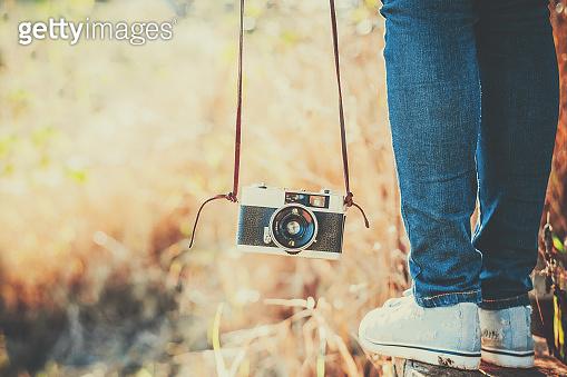 woman with retro camera