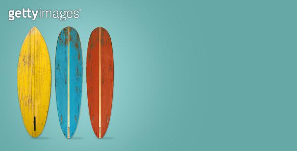 Vintage surfboard on color background.
