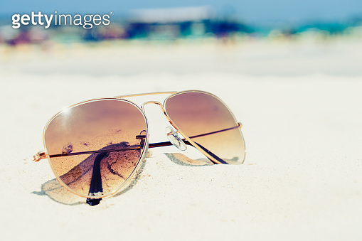 sunglasses on sand beach