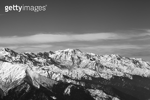 Black and white snowy mountains in nice sunny evening