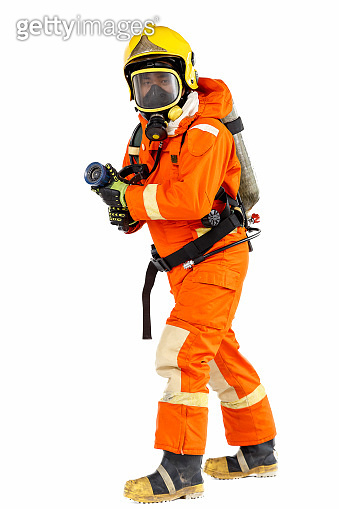 Firefighter with mask and air-pack fully protective suit and working with fog nozzle. Isolated on white background