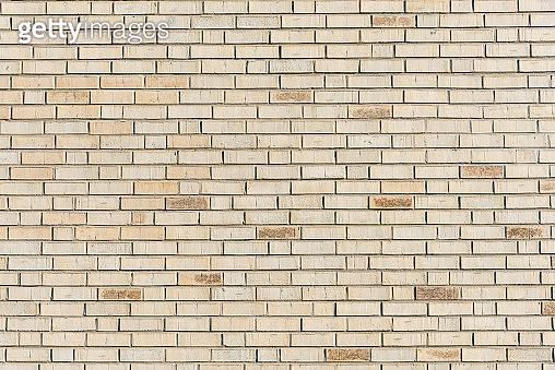 Beige brick wall background