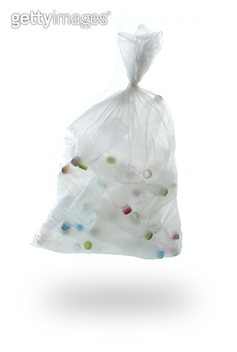garbage bag with plastic bottles on a white background.,recycling concept
