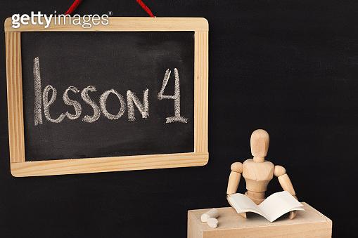 Lesson 4 written with chalk on blackboard.